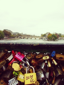 The Pont des Arts has a kitschy but cute tradition. Lovers write their names or initials on a padlock, lock it onto the bridge, and throw the key in the river.