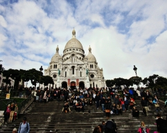 "Battling the crowds on a Sunday at the Basilica of the Sacred Heart, at the summit of the ""butte"" Montmartre, the highest point in the city of Paris."