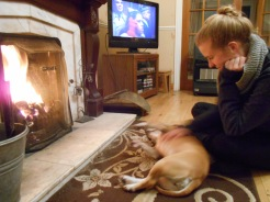Katie hanging out with Nala by the fire.